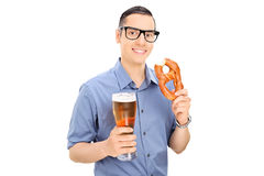 Man eating pretzel and drinking beer Royalty Free Stock Images