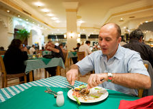 Man eating in a reastaurant Stock Photo