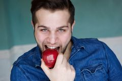 Man eating red organic apple Stock Photo