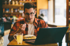 Man eating in a restaurant and enjoying delicious food Royalty Free Stock Photography