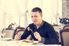 Man eating in a restaurant Stock Image