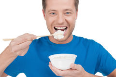 Man eating rice. Stock Photo