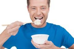 Man eating rice. Stock Photo