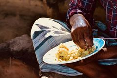 Man eating rice with right hand stock photograph stock photography