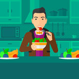 Man eating salad. Royalty Free Stock Photo