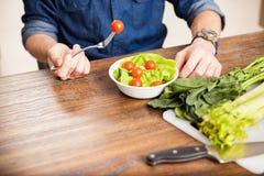 Man eating a salad up close Royalty Free Stock Images