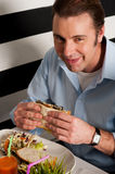 Man eating sandwich in a restaurant Royalty Free Stock Photography