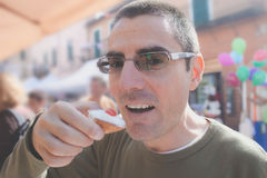 Man Eating Sicilian Cannolo Royalty Free Stock Photos