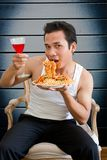 Man eating spaghetti Stock Photo