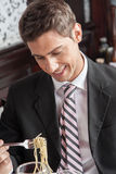Man eating spaghetti Royalty Free Stock Photography