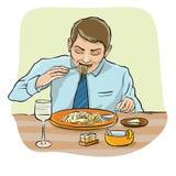 Man eating spaghetti Stock Photo