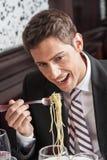 Man eating spaghetti Royalty Free Stock Photos