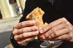 Man eating a spanish omelette sandwich Stock Photography