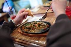 Man eating stewed kidneys of lamb Stock Image