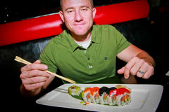 Man Eating Sushi Stock Image