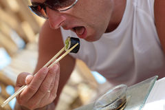 Man eating sushi Stock Photos