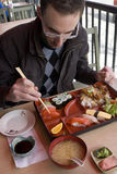 Man eating traditional bento box Royalty Free Stock Images