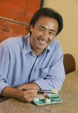 Man Eating Sushi portrait Stock Photos