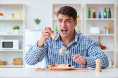 The man eating tasteless food at home for lunch Stock Photos