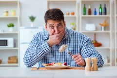 The man eating tasteless food at home for lunch Stock Images