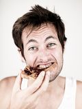 Man eating toast with peanut butter and jelly Royalty Free Stock Image