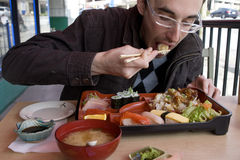 Man eating traditional bento box Royalty Free Stock Image
