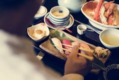 Man eating traditional Japanese food Stock Image