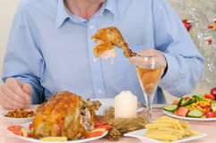 Man eating turkey Royalty Free Stock Images