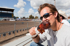 Man Eating a Turkey Leg stock image