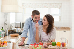 Man eating vegetables with his wife Royalty Free Stock Image