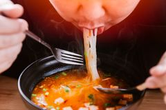 Man eating very hot and spicy noodle tasty yummy. Meal Royalty Free Stock Photos