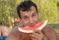 Man eating watermelon Royalty Free Stock Photo