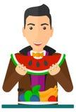 Man eating watermelon Stock Image