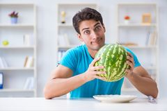 The man eating watermelon at home Stock Photo