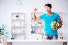 The man eating watermelon at home Stock Images