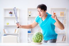The man eating watermelon at home Stock Image