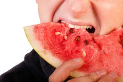 Man eating  watermelon slice Stock Images