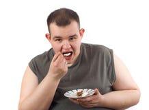 Man eats cake royalty free stock images