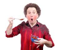 A man eats chilli Royalty Free Stock Image