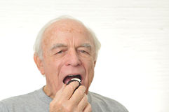 Man eats the cream from a cream filled cookie Stock Photography