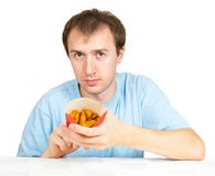 Man eats French fries isolated Stock Photo