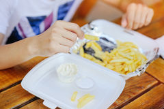 Man eats French fries. Road fast food Stock Photo