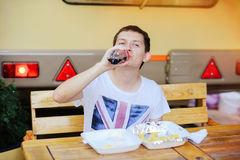 Man eats French fries. Road fast food Stock Photos