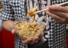 Man eats fried rice with chopsticks for sushi Royalty Free Stock Photography