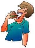 Man eats hamburger Stock Photography