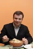Man eats hash soup. Armenian National dish as early breakfast royalty free stock photos