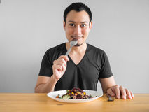 Free Man Eats Healthy Food. Stock Photos - 98033123