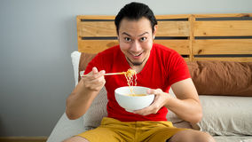 Man eats noodles. Stock Photos