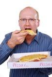 Man eats pizza Royalty Free Stock Image