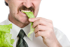 Man eats sheet of the salad Royalty Free Stock Photography